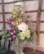 This Beautiful Vase w/Orchids,draping ameranthus,etc.