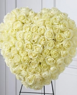 A Beautiful all White Rose Heart ,a Spray of Flowers can be added