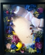This is a frame of Flowers Dried for the Special Family after their loved ones Service.