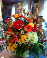 Orange Gerbers,yellow roses,lime hydrangea,etc. make this nice large arrangement just beautiful