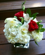 Roses,Hydrangeas,even orchids make this arrangement so special