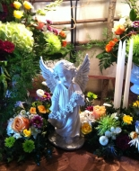3 matching floral piece\'s for a Special Service.Can be used around an Angel,Statue or Urn.The Candles add so much to the service also