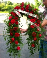 This is a beautiful Red Rose Garland & was sent in Loving Memory of their Brother