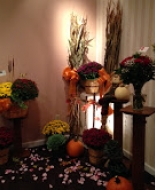 A beautiful fall setting we crated at Glenville Funeral Home for our dear Friend